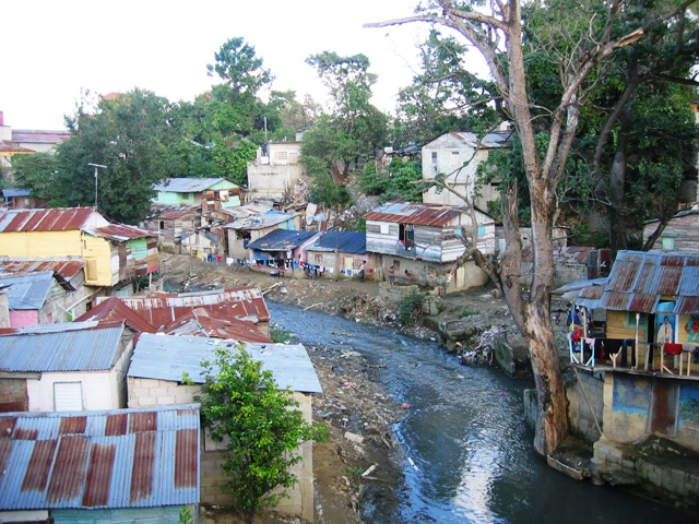 A group of shacks of the type typical in the Dominican Republic today. It will require the revolutionary reorganization of society to solve problems like these.