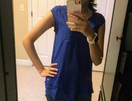 girl wearing blue calvin klein top