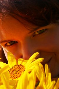 Woman with flower to illustrate an article about language concerning autism