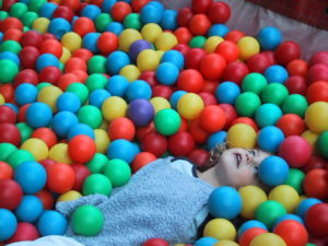 girl ball pool - illustrating autism article on spectra.blog