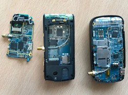 The internal workings of three early smartphones show a metallic antenna attached to a plastic surface toward the top of each device.