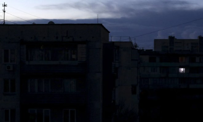 A single light illuminates a room during a blackout in Ukraine, 2015.