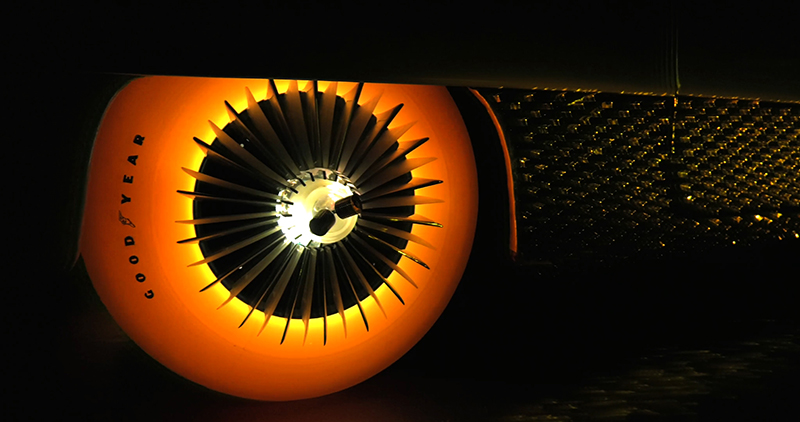 Orange car tyre illuminated from within