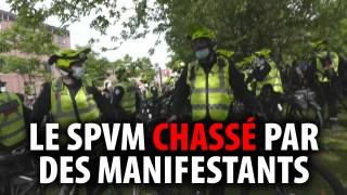 LE SPVM CHASSÉ PAR DES MANIFESTANTS À MONTRÉAL