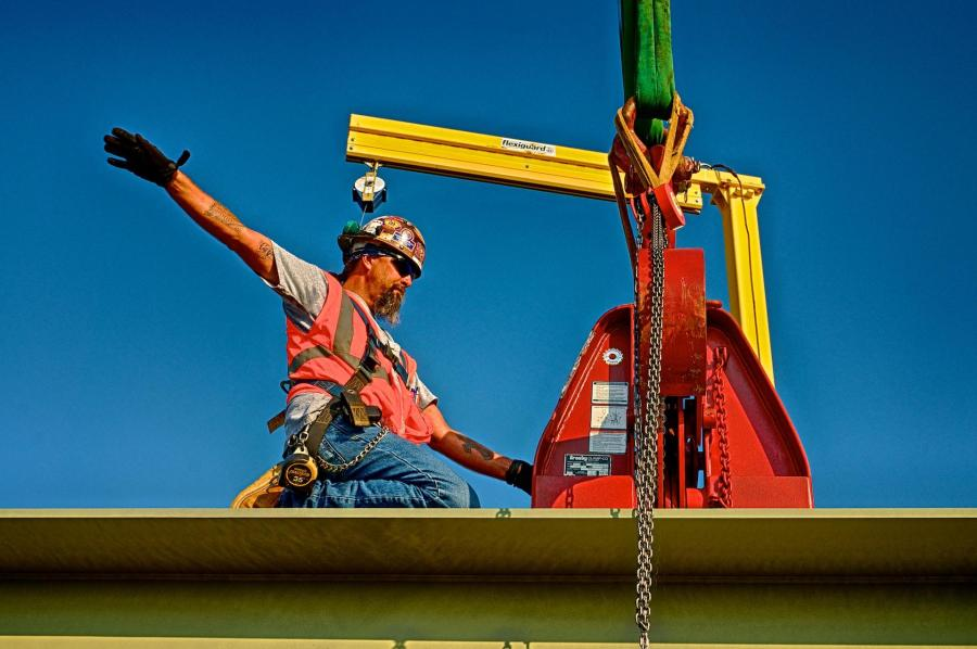 Ironworker Signaling the Crane Operator to Lift a Bridge Beam for The Downtown Span of the Ohio River Bridges Project.