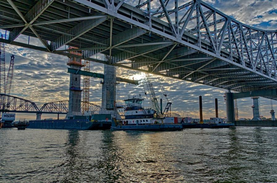 The Walsh Group towboat Wayne C delivers a barge to the worksite in the Ohio River.