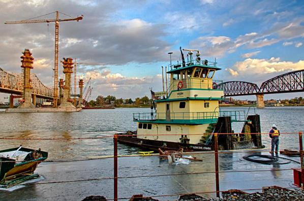 The Walsh Group towboat Kathleen Ohara picks up Pete Rimert at the start of the day.