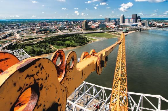 Looking over the top of the tower crane on pier four at the Louisville skyline.