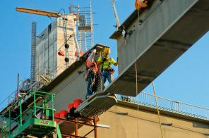 Trey Dewitt and Barry Clifford setting a a side girder for the downtown span