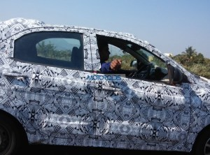 Tata-Kite-Hatchback-Spied-In-Pune-Side-600x445.jpg.pagespeed.ce.MMWf4NuY647YT0-FxZYS