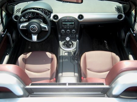 The interior of the MX-5 has the perfect blend of driver-focused tools and modern amenities that make it a great daily-drivable and capable sports car.