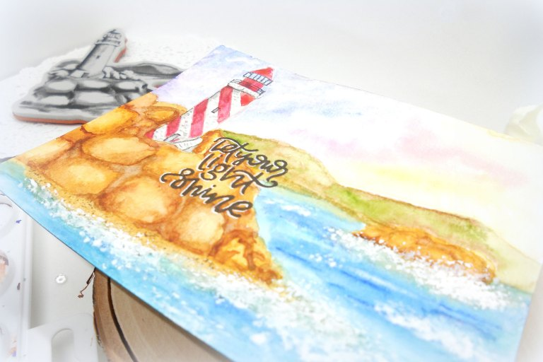 Video Friday | Lighthouse with Kelly for Spellbinders using: DSC-044 Lighthouse, SDS-097 Light Shine #spellbinders #cardmaking #stamping #watercolorcard #adultcoloring