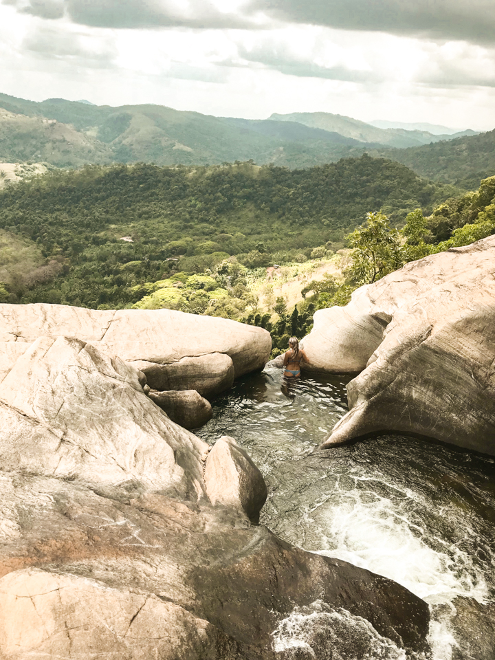 spellbound travels girl at diyaluma waterfalls sri lanka
