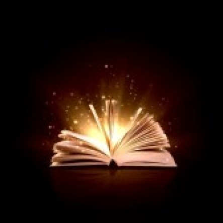 spellcasting image-of-opened-magic-book-with-magic-lights