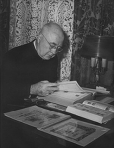 Cardinal Spellman looking at stamps