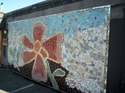 Mosaic flower mural around the corner from the Rue de Merde