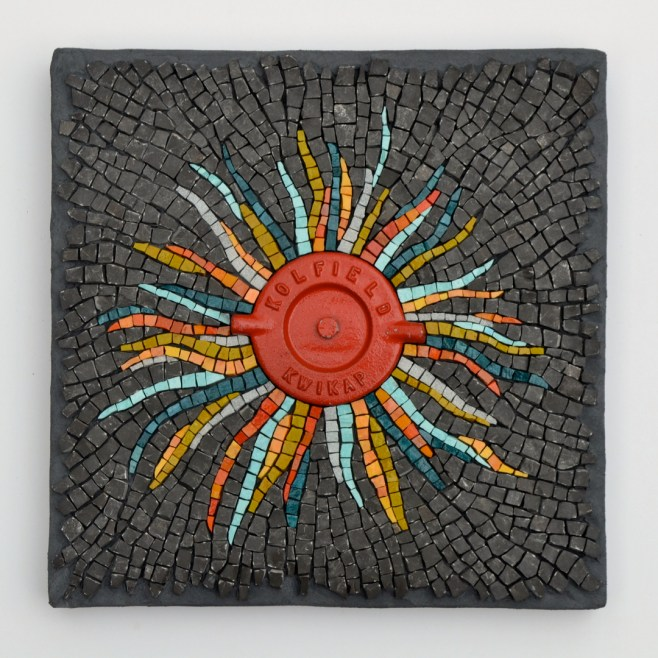 """""""Incendio"""" (2013) -- stone from the banks of the Ottawa River, smalti, and a fire hose cap, 12"""" x 12"""""""