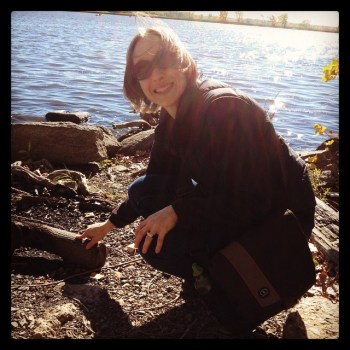 Scooping up those two little red rocks (and one bit of rusty metal) in Lachine, QC.
