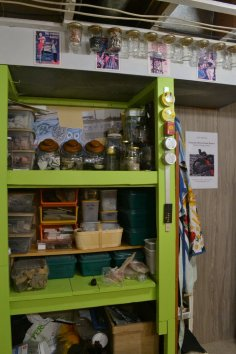 Storage solutions! Salvaged shelves (painted an obnoxiously bright green because I just happened to have some in stock), mason jars screwed to the ceiling, and old tins held up with rare earth magnets.