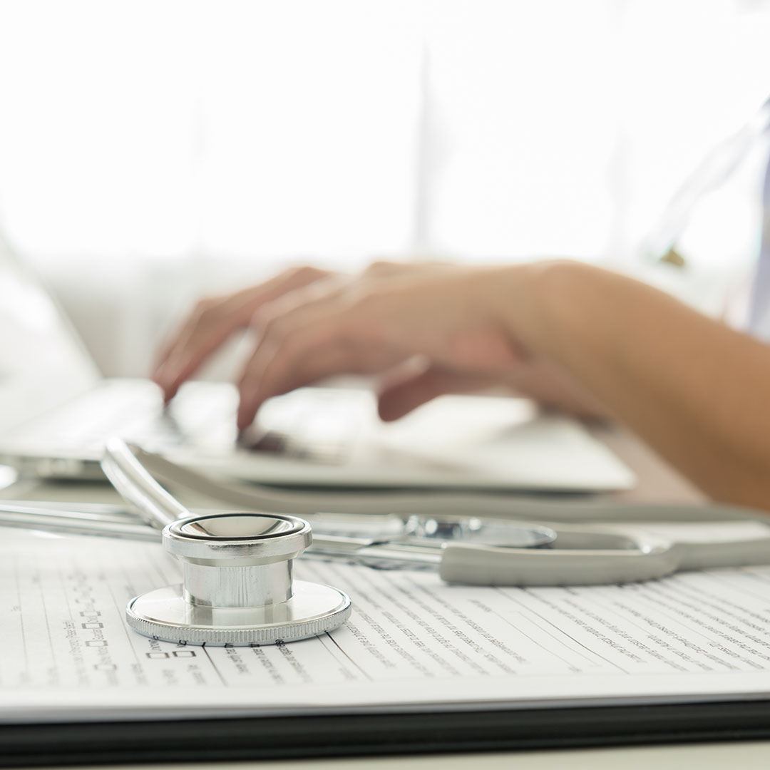 Doctor typing on a laptop - Business Solutions - Savannah, GA