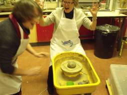 Kerstin throws the clay down