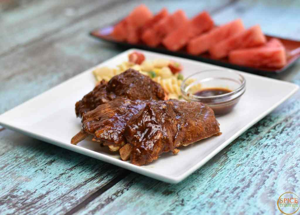 Fall-off-the-bone Pork ribs Instant pot by Spice Cravings. This recipe of Fall-Off-The-Bone BBQ Pork ribs uses a rich spice blend to add a lot of flavor and the instant pot to push all that flavor into the ribs. #food #foodie #foodblogger #delicious #recipe #instantpot #recipes #easyrecipe #cuisine #30minutemeal #instagood #foodphotography #tasty