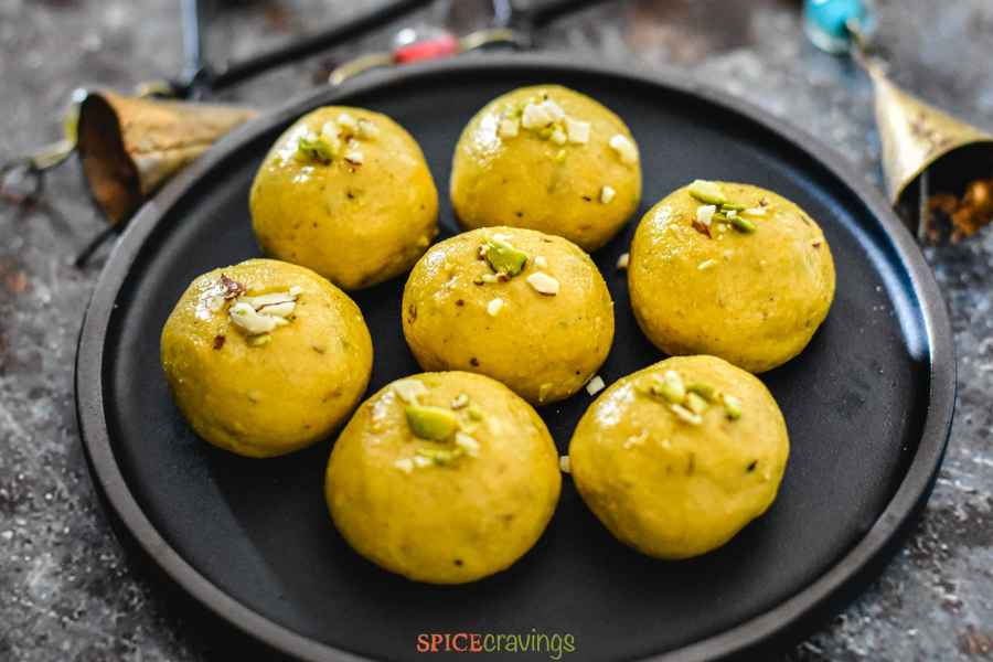 Plate of 7 besan ladoo on a rustic background