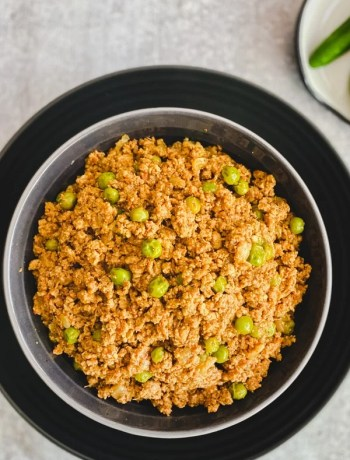 Keema Matar, Indian ground meat simmered with Indian spices and green peas, served in a copper bowl