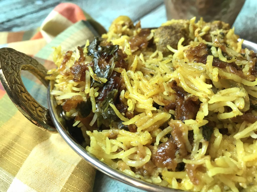 Lamb Dum Biryani is a meat and rice dish where meat marinated in bold Indian spices is cooked with fragrant Basmati rice and aromatics like onions & herbs. #food #foodie #foodblogger #delicious #recipe #instantpot #recipes #easyrecipe #cuisine #30minutemeal #instagood #foodphotography #tasty #indian #curry