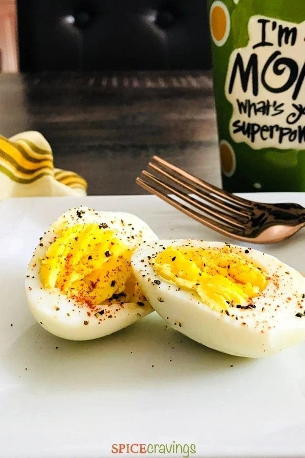 hard Boiled Egg cut in half, with salt and pepper