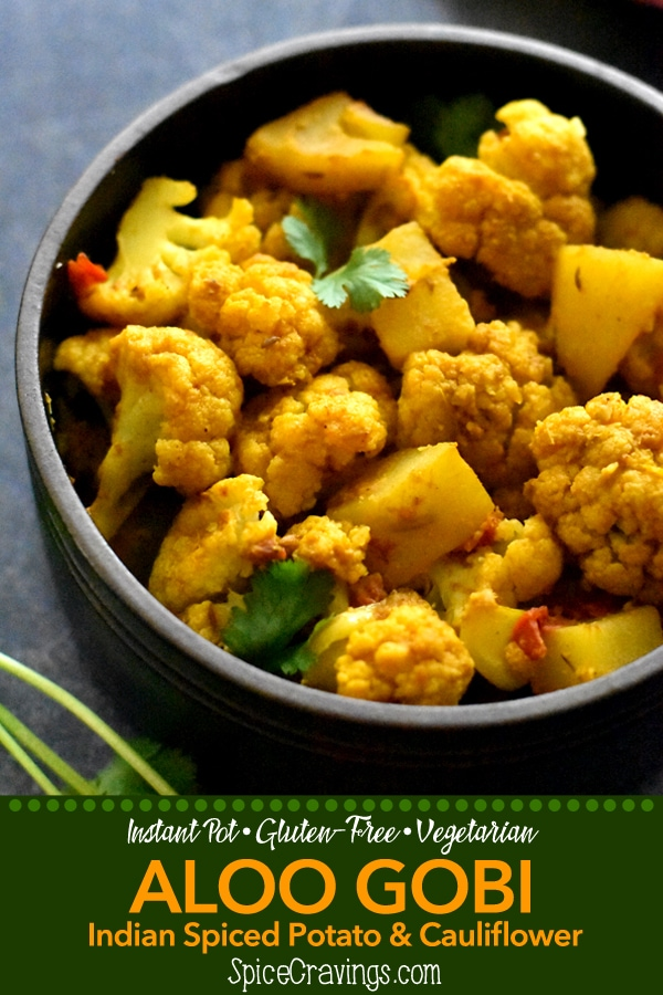 Aloo Gobi is a popular vegetarian side from north-Indian cuisine. Potatoes and cauliflower are cooked with ginger & garlic, and seasoned with Indian spices. #spicecravings #indian #vegetarian #sidedish #indiancuisine #instantpot
