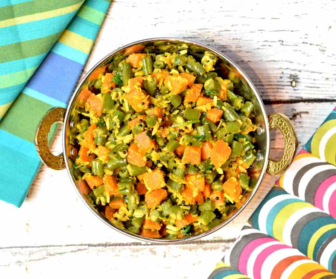 Green Beans and Carrot instant pot or stir fry by Spice Cravings. Crisp green beans and carrots sautéed with mustard seeds and coconut flakes,and seasoned with salt, coriander and cayenne. This super simple and amazingly easy vegetable side-dish is a great accompaniment to many entrée. #food #foodie #foodblogger #delicious #recipe #instantpot #recipes #easyrecipe #cuisine #30minutemeal #instagood #foodphotography #tasty