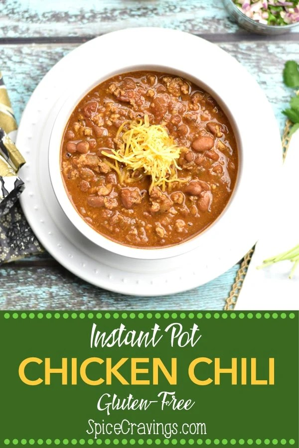 Try this tasty and healthy recipe for Instant Pot Chicken Chili. Made with ground chicken, taco seasoning and creamy pinto beans, you'll love this protein and fiber packed warm bowl of goodness, on a cold, winter night too.  #food #foodie #foodblogger #delicious #recipe #instantpot  #recipes #easyrecipe  #cuisine  #30minutemeal  #instagood #foodphotography #tasty