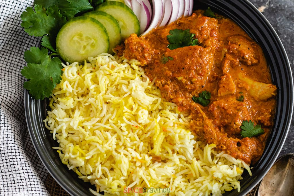 """Instant Pot Easy Butter Chicken with Saffron Rice by Spice Cravings. Tender and juicy chicken, cooked in a creamy-buttery tomato sauce, served with Saffron flavored Basmati Rice! This 'EasyButter Chicken' is a quick & easy """"weeknight"""" recipe. I simplified the butter chicken recipe, cut down cooking time, and still retained that amazing delicious flavor. #cooking #food #recipe #recipes #foodphotography #foodblogger #yummy #delicious #foodie"""