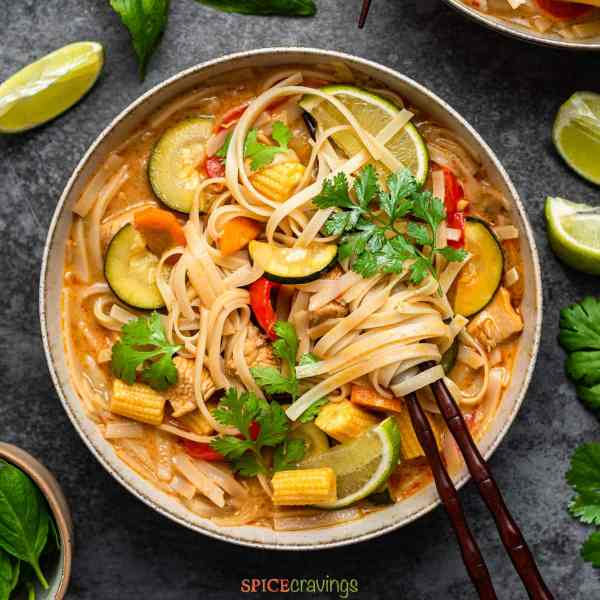 Top shot of a bowl of thai red curry soup