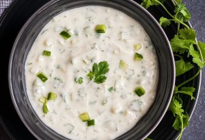 Cucumber Yoghurt Dip / Cucumber Raita, by Spice Cravings. Cucumber Raita is a yoghurt dip made by mixing together freshly chopped cucumber, cilantro, yogurt, salt, an Indian spice blend called Chaat Masala. #food #foodie #foodblogger #delicious #recipe #instantpot #recipes #easyrecipe #cuisine #30minutemeal #instagood #foodphotography #tasty