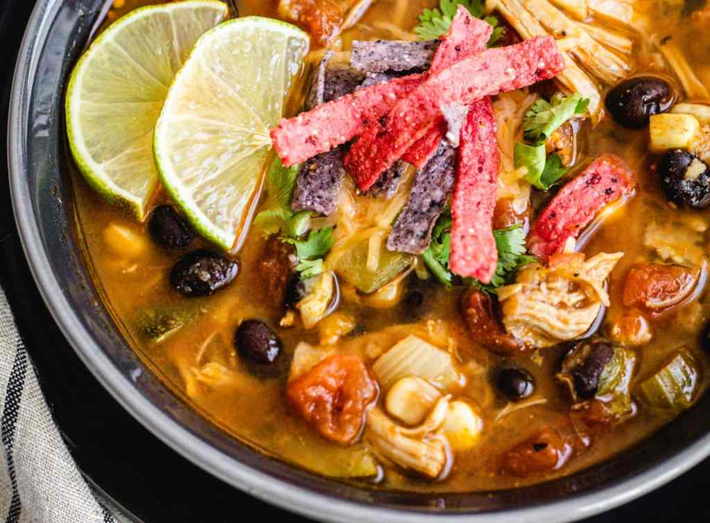 Instant pot chicken tortilla soup served with tortilla chips