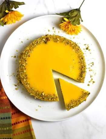 Top shot of a sliced Mango cheesecake