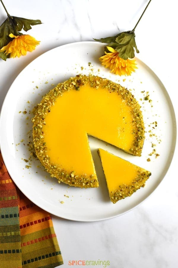 Top shot of a sliced Mango cheesecake