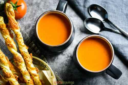 Roasted Red Pepper Tomato Soup served with cheese straws