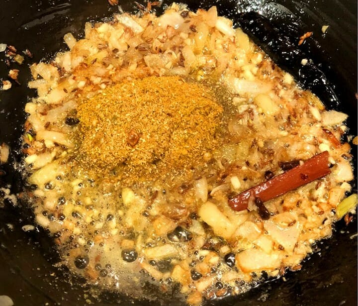 frying ground spices on onions