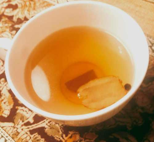 Winter spices good for cold. Indian Kadha Herbal Spice tea in a white cup