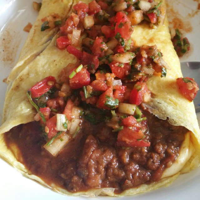 chili is an omelette and topped with fresh salsa