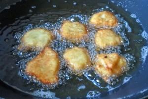 apple churro fritter frying in hot oil