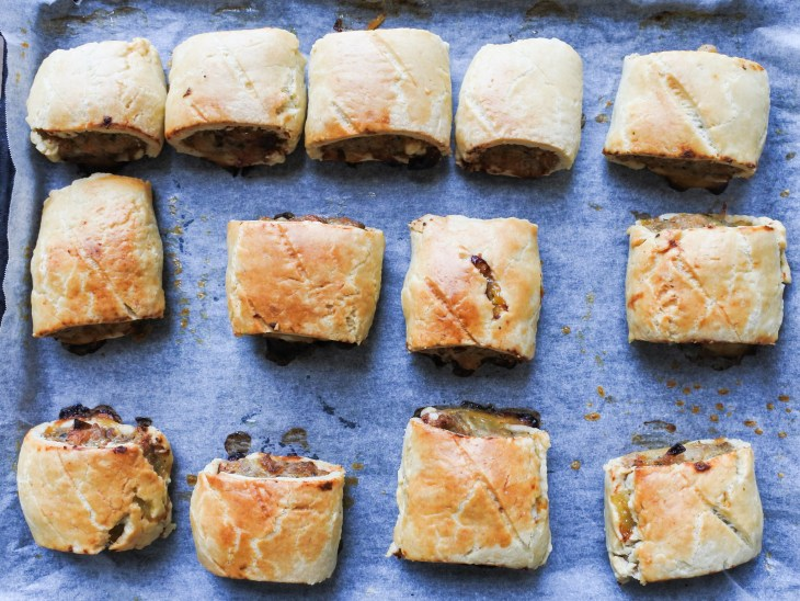golden brown sausage rolls on a baking tray