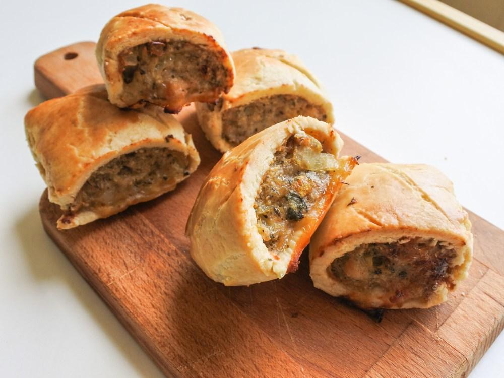 sausage rolls on a cutting board