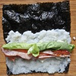 nori sheet with sliced tomatoes, bacon and lettuce