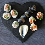 blt sushi rolls on heart shaped slate