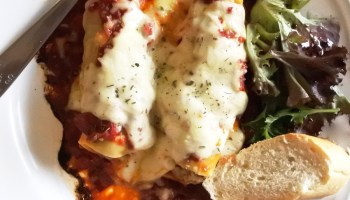pork cannelloni served with bread and salad