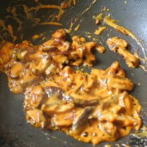 mushrooms frying with Thai chile paste